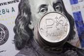 Курс рубля может ослабнуть до отметки 58 за доллар